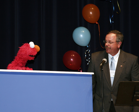ELMO and Tennessee Education Commissioner Dr. Tim Webb at NPT and WLJT's PBS Kids Raising Readers Event at War Memorial Auditorium