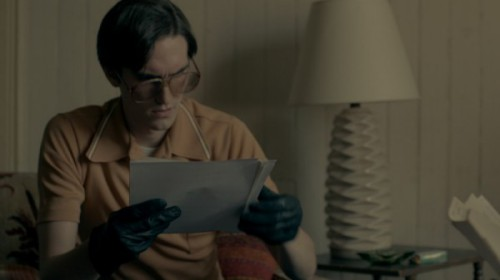 Keith Forsyth (played by Daniel S. Taylor) reads a stolen document. Credit: Courtesy of Andreas Burgess