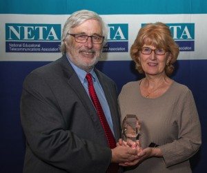 NPT's Beth Curley accepting NETA Award from Skip Hinton, President of the National Educational Telecommunications Association