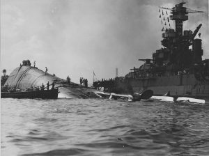 USS Oklahoma capsized after the attack on Pearl Harbor. Credit: Courtesy of National Archives.