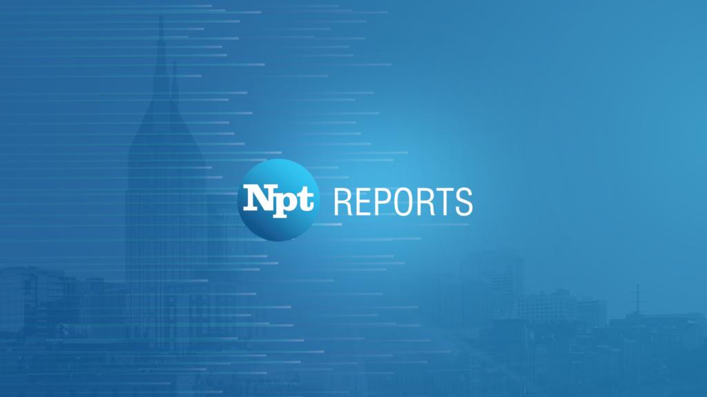 NPT Reports Logo with Batman building backdrop